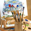 Paints and brushes in the composition — Foto Stock