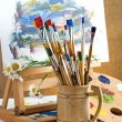Paints and brushes in the composition — Stockfoto