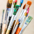Paints and brushes in the composition — Stock Photo