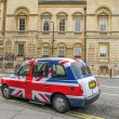 Union Jack cab - Stock Photo