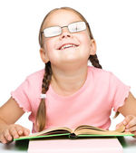 Cute little schoolgirl with a book — Stock Photo