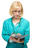 Porträtt av en kvinna som bär läkare uniform — Stockfoto
