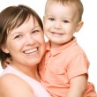 Stock Photo: Portrait of happy mother hugging her son
