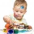 Little boy is playing with paints — Stock Photo #13181607