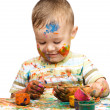 Little boy is playing with paints — Stock Photo #13181608