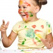 Portrait of a cute girl playing with paints — Stock Photo #13181696