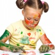 Portrait of a cute girl playing with paints — Stock Photo #13181698