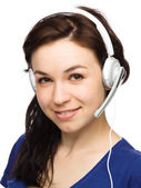 Lovely young woman is talking to customers — Stock Photo