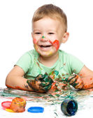 Child is grabbing some paint using fingers — Foto Stock