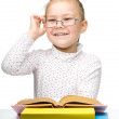 Cute cheerful little girl reading book — Foto Stock