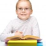 Cute cheerful little girl reading book — Stock Photo #13380315
