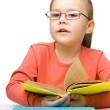 Cute little girl reading book — Stock Photo #13380345