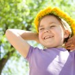 Portrait of a little girl with dandelion wreath — Stock Photo #13380529