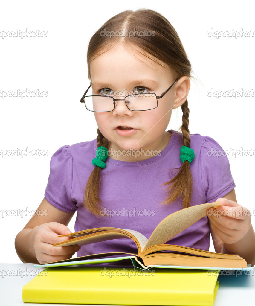 Cute little girl reading book wearing glasses, isolated over white — Stock Photo #13380485