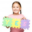 Stock Photo: Cute little girl is holding Yes slogan