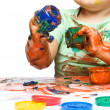 Child is grabbing some paint using fingers — Stock Photo