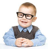 Portrait of a cute little boy wearing glasses — Stock Photo