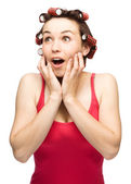 Woman is holding her face in astonishment — Stock Photo
