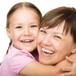 Portrait of a happy mother hugging her daughter - Stock Photo