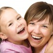Portrait of a happy mother hugging her daughter — Stock Photo