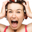 Woman is screaming holding her head with hands — Stock Photo