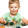 Royalty-Free Stock Photo: Child is grabbing some paint using fingers