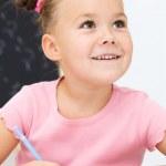 holčička je psát pomocí pera — Stock fotografie #14884043