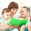 Mother is reading book for her children — Stock Photo