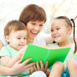 Mother is reading book for her children — Stock Photo #15314591