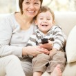 Royalty-Free Stock Photo: Mother and her son are watching tv