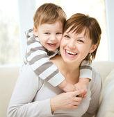 Happy son piggybacking his mother — Stock Photo