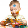 Royalty-Free Stock Photo: Little boy is playing with paints