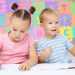 Children are writing on their books — Stock Photo