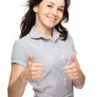 Woman is showing thumb up gesture — Stock Photo
