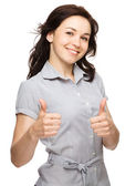 Woman is showing thumb up gesture — Stockfoto