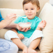 Cute little boy is fed using spoon — Stockfoto #16927847