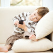 Little boy is watching tv — Stockfoto