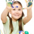 Stock Photo: Little girl is painting eggs preparing for Easter
