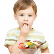 Portrait of a boy with candies — Stock Photo #17432015