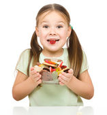 Happy girl with candies — Stock Photo