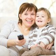 Mother and her son are watching tv — Stock Photo
