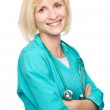 Stock Photo: Portrait of womwearing doctor uniform
