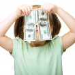 Little girl is covering her eyes with dollars — Stock Photo