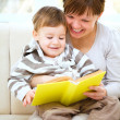 Royalty-Free Stock Photo: Mother is reading book for her son