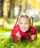 Portrait of a little girl in autumn park — Stock Photo