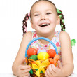 Little girl with basket full of colorful eggs - Stock Photo
