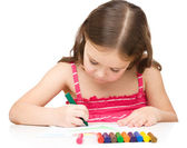 Little girl is drawing using a crayon — Stock Photo