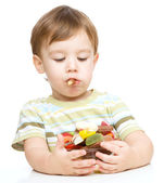 Portrait of a boy with cookies — Stock Photo