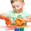 Little boy is playing with paints — Stockfoto