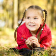 Portrait of a little girl in autumn park - Stock Photo